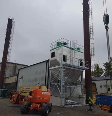 Flue gas filtration of biomass boilers
